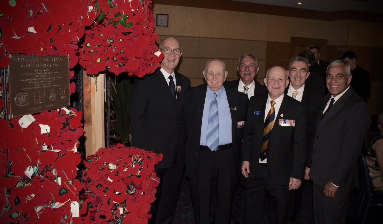 From left to right: Ray Buck, Keith Buck, David Cope, President centenary suburbs rsl sub branch mr Alan Worthington. MBE, len paarman and georges lefevre next to the ANZAC commemorative cross