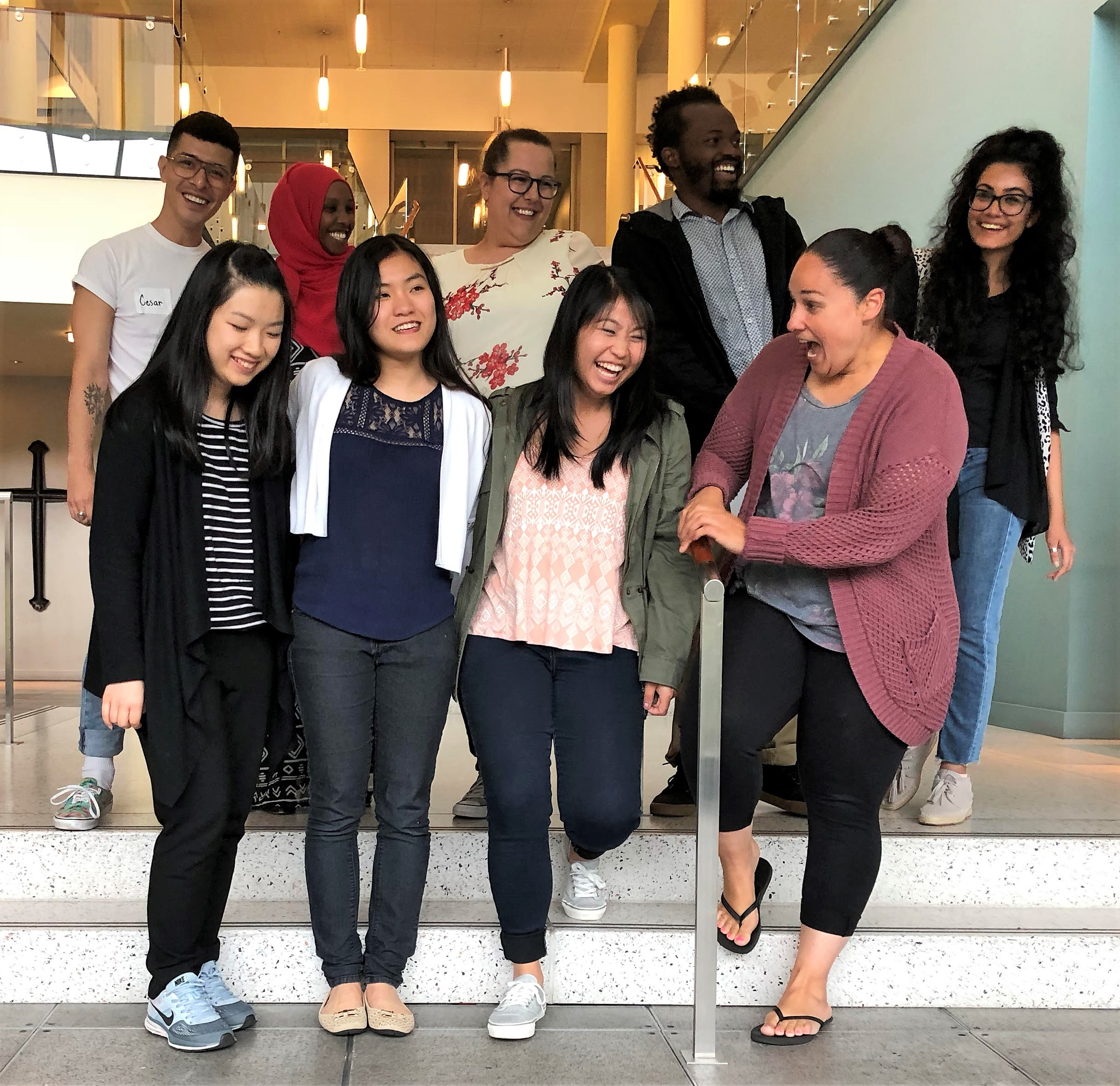 "Front row, left to right: Yue Zhang, Ngan ""Meghan"" Nguyen, Chloe Zabrek, Stephanie Sanchez. Back row, left to right: Cesar Rios III, Farhia ""Dekha"" Hassan, Jasmina ""Mina"" Omerovic, Michel Mugisha, Chhavi Mehra"