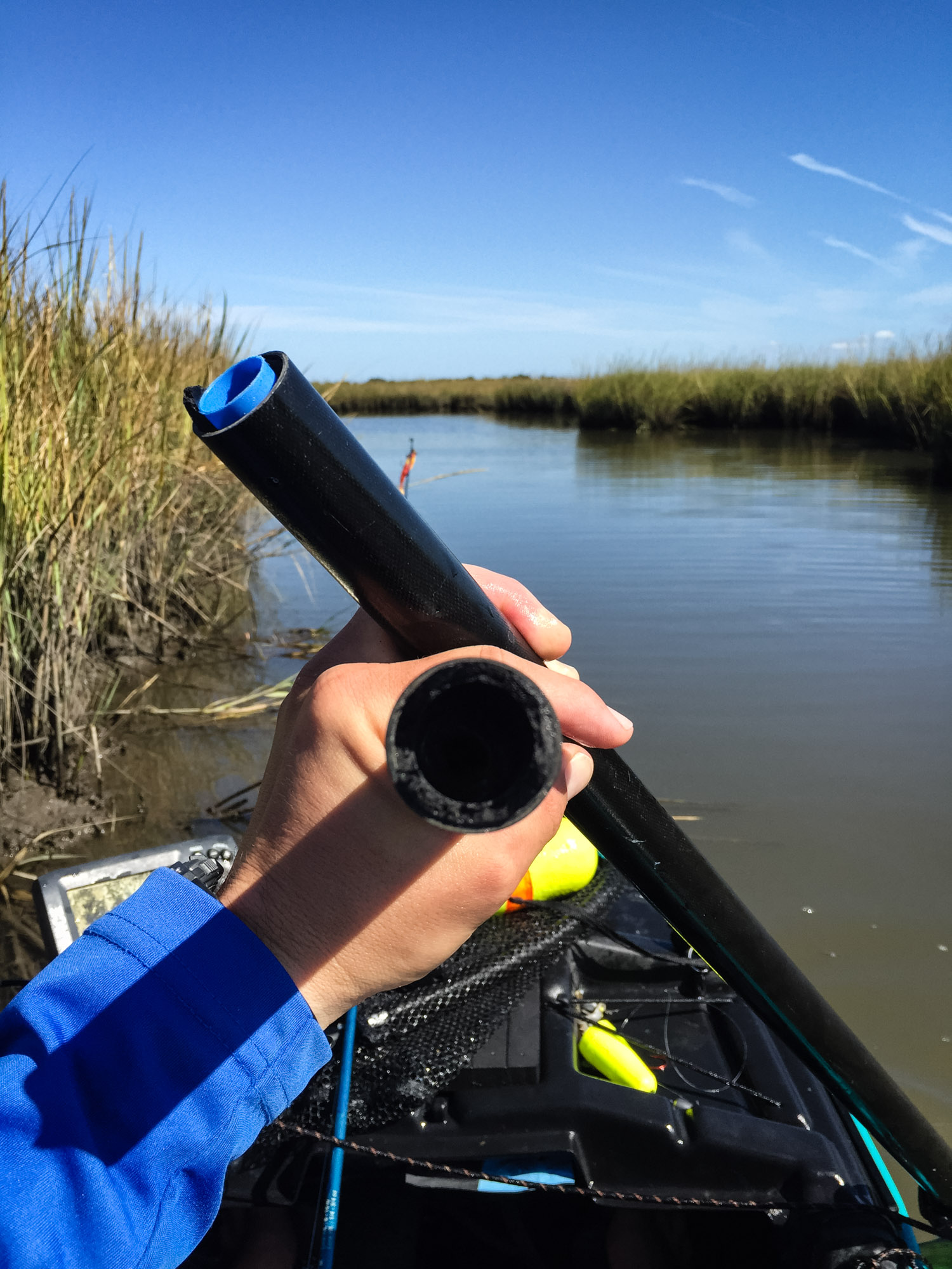 Broken paddle in the marsh