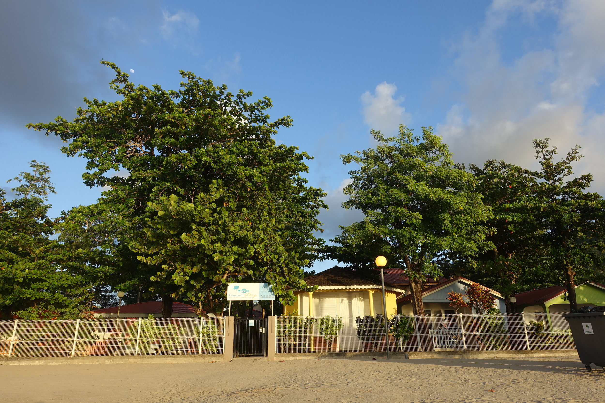 the front gate or coubaril village leads on to the beach