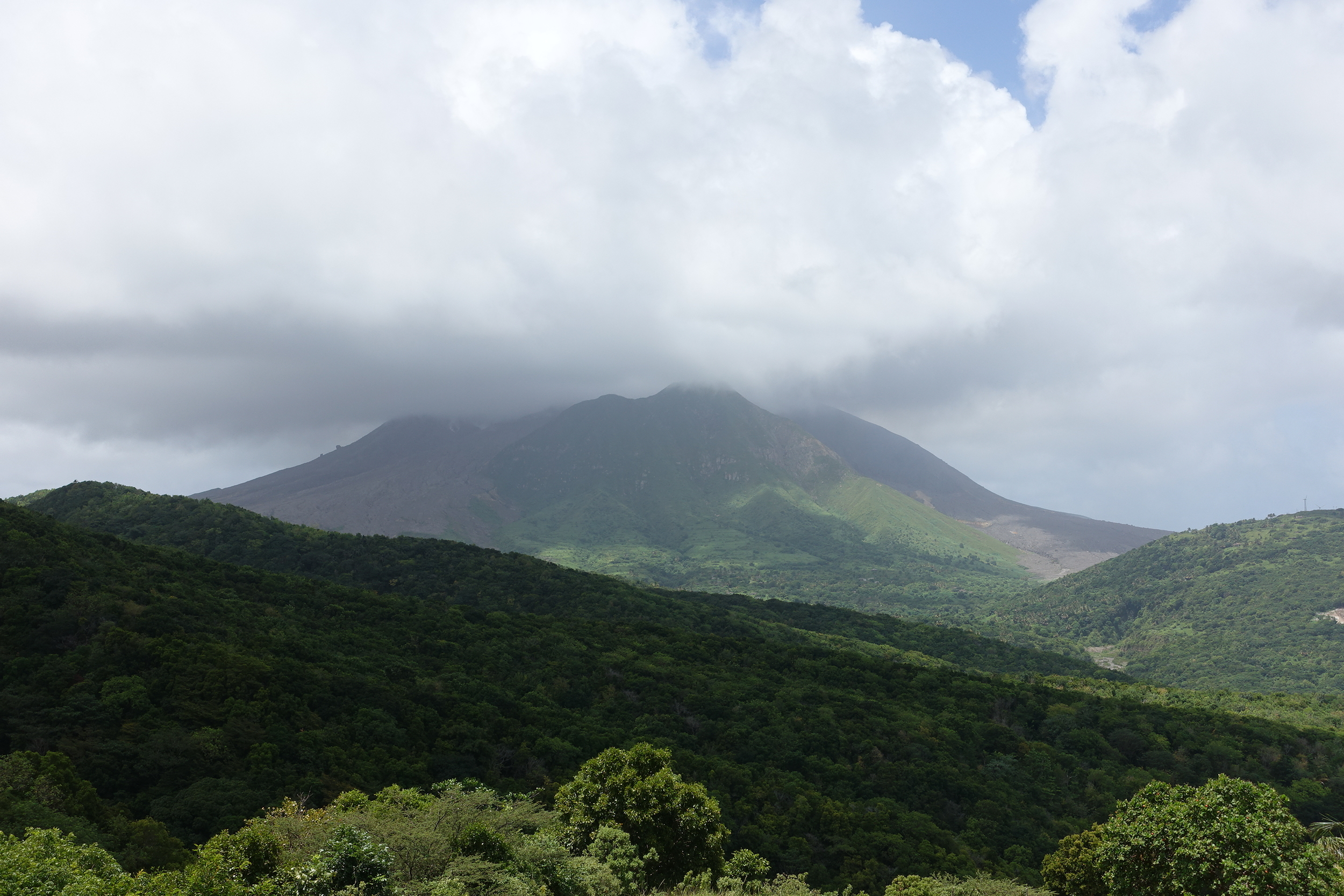 Soufriere hills volcano shrouded in clouds as seen from the Montserrat Volcano Observatory