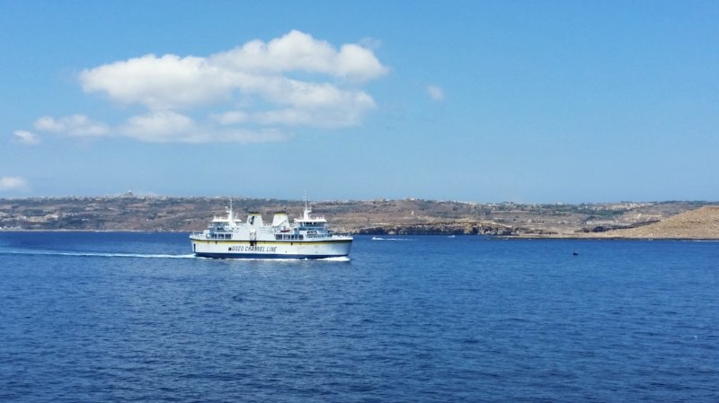 gozo ferry with gozo in the background