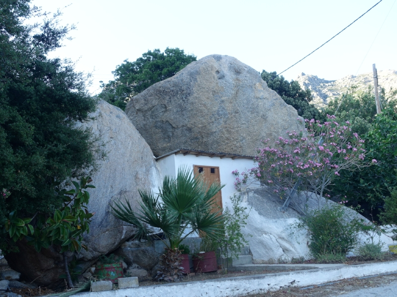 house built between two large boulders to hide from pirates