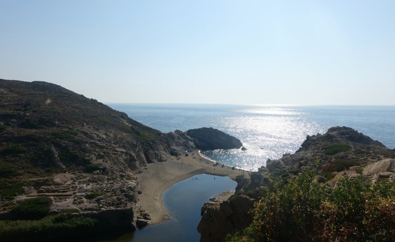 the beach at nas - the remains of the temple of artemis are on the left