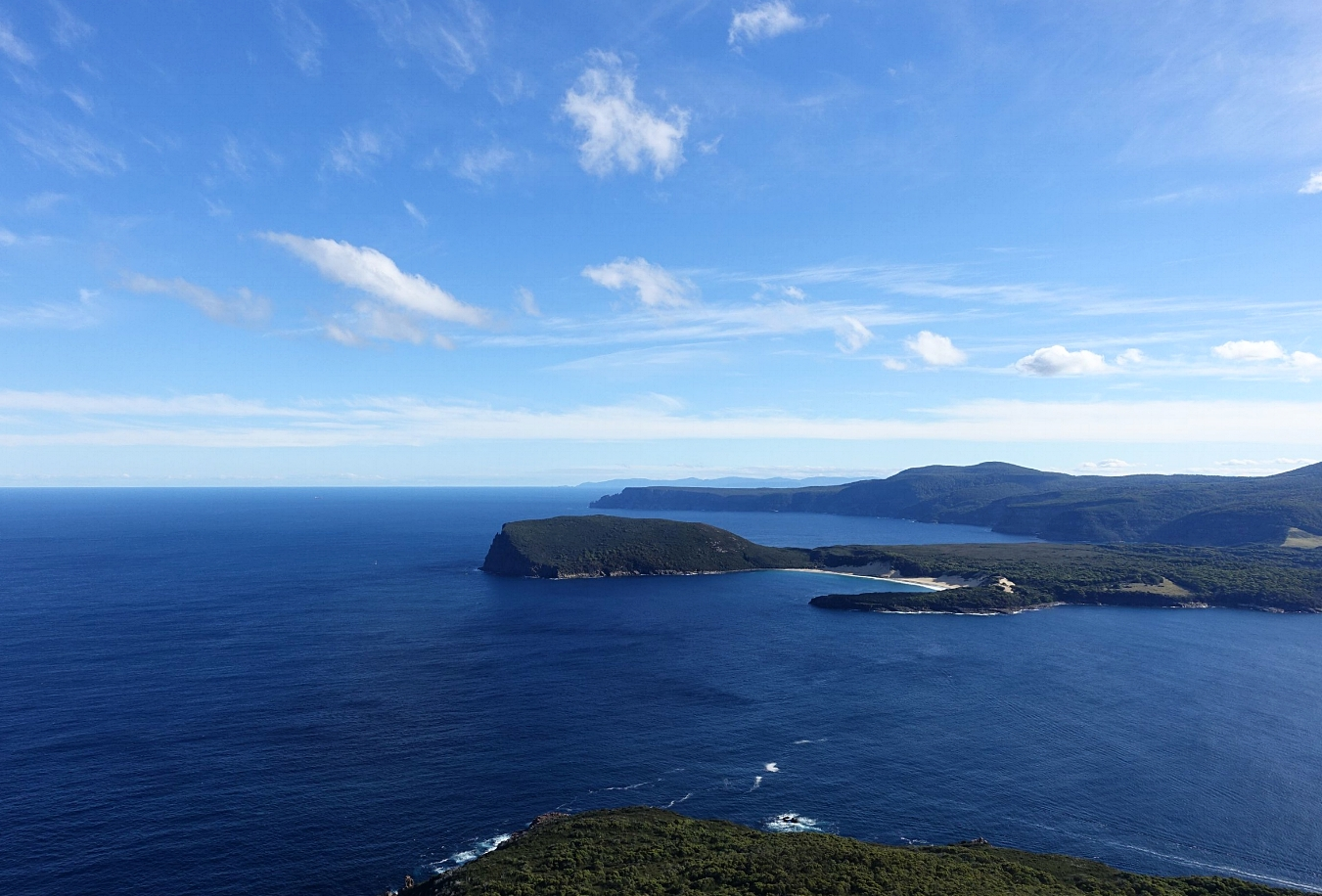 crescent bay and brown mountain in foreground with cape Raoul behind