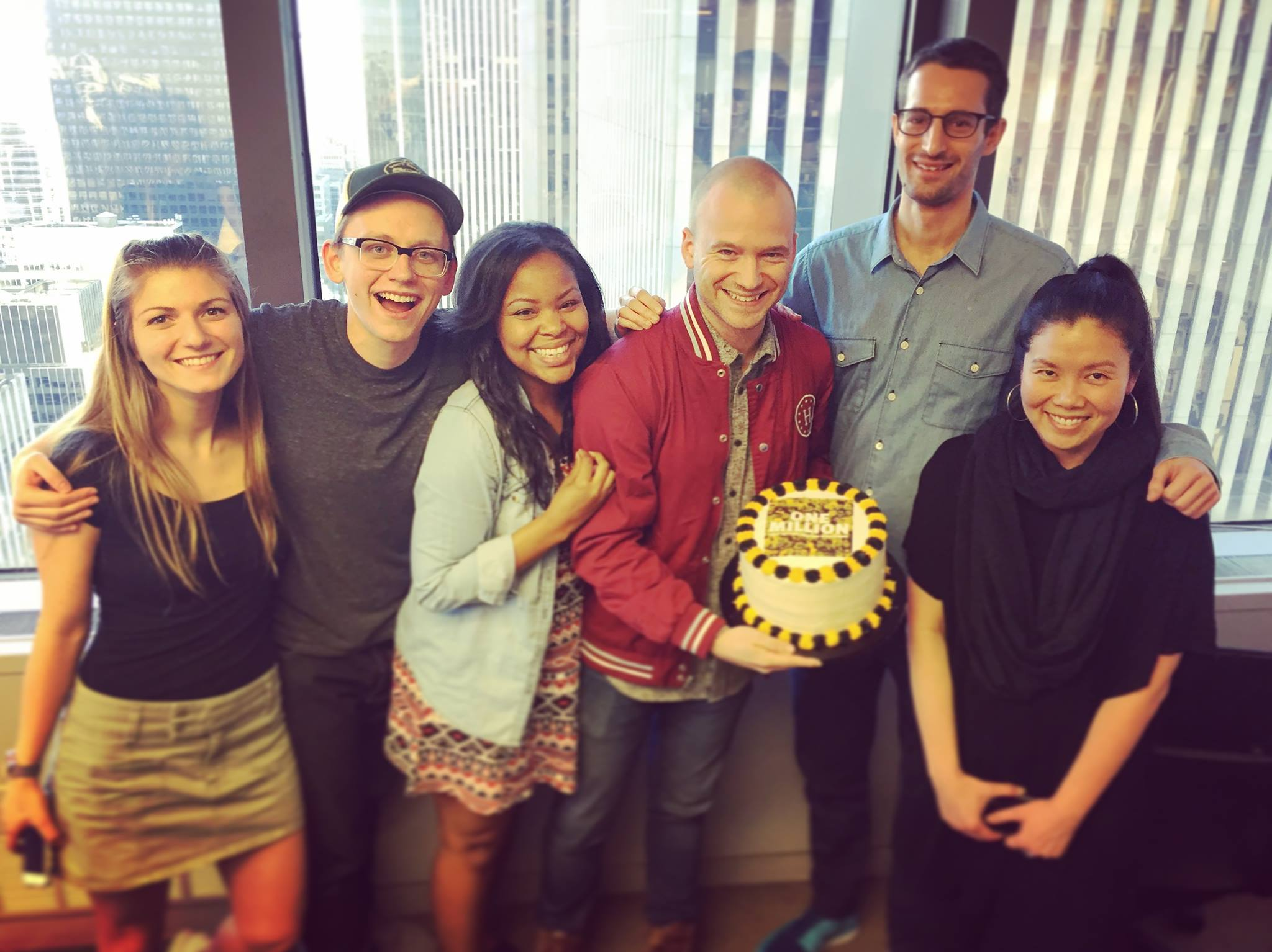 The Hot Ones team celebrating First We Feast's first one million Youtube subscribers.