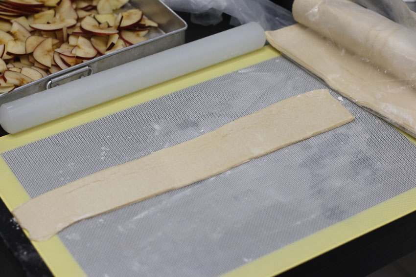 Now onto the puff pastry. I bought this 1kg puff pastry from Bake With Yen (RM11++) and it yielded me about 36 pieces. Make sure you keep it in the fridge until you are ready to work with it. With our humid temperature, you have to work fast before it starts getting sticky. Use flour to keep your rolling pin from sticking to your pastry. Cut out strips from your pastry sheets and roll it out once.
