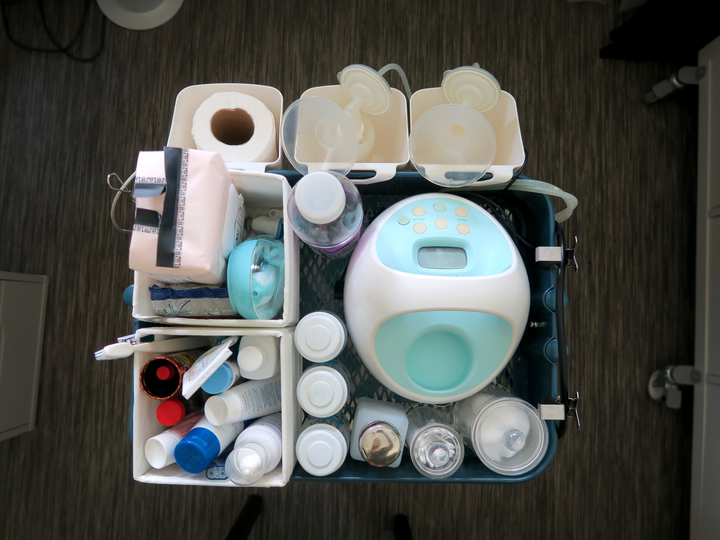 a. Pump, milk storage bottles, water bottle, cotton buds, cotton swabs, water pump (like they used in nail salons – to clean her face)  b. Wet wipes, nail clipper,  nipple cream, nasal spray, toothbrush (for her hair), baby lotions and ointments  c: Ikea SUNNERSTA Containers – Toilet roll, earphones (under toilet roll), flanges  *All organizers used are linked   here