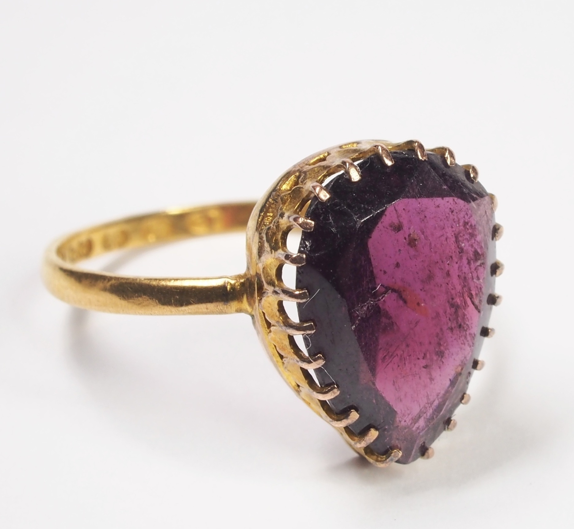 Genuine Antique - This is a genuine antique early Victorian 22ct yellow gold rhodolite garnet ring, made in England in 1847. It contains a rhodolite garnet which has suffered some small chips and has some surface pits and cracks, consistent with the age of the ring. The ring is handmade and the setting contains multiple claw tips that are quite finely shaped to hold the centre gem.