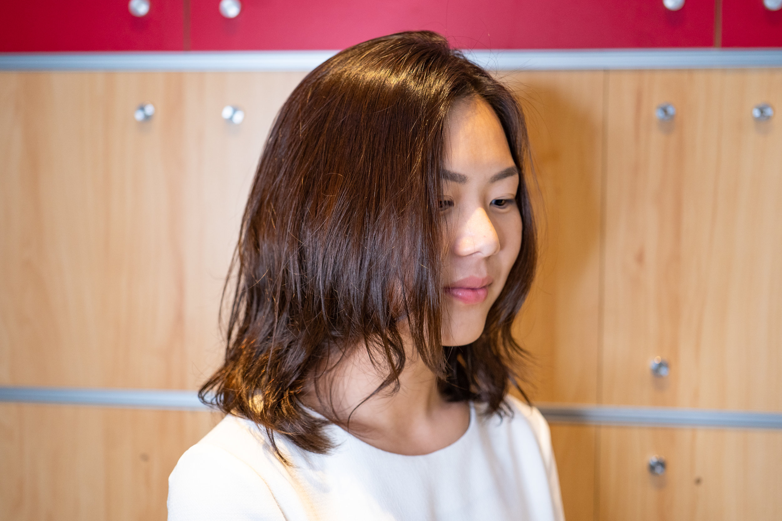Side profile of pretty female hair model with dark brown hair at Du Sol Beauty Singapore located at Novena Square 2