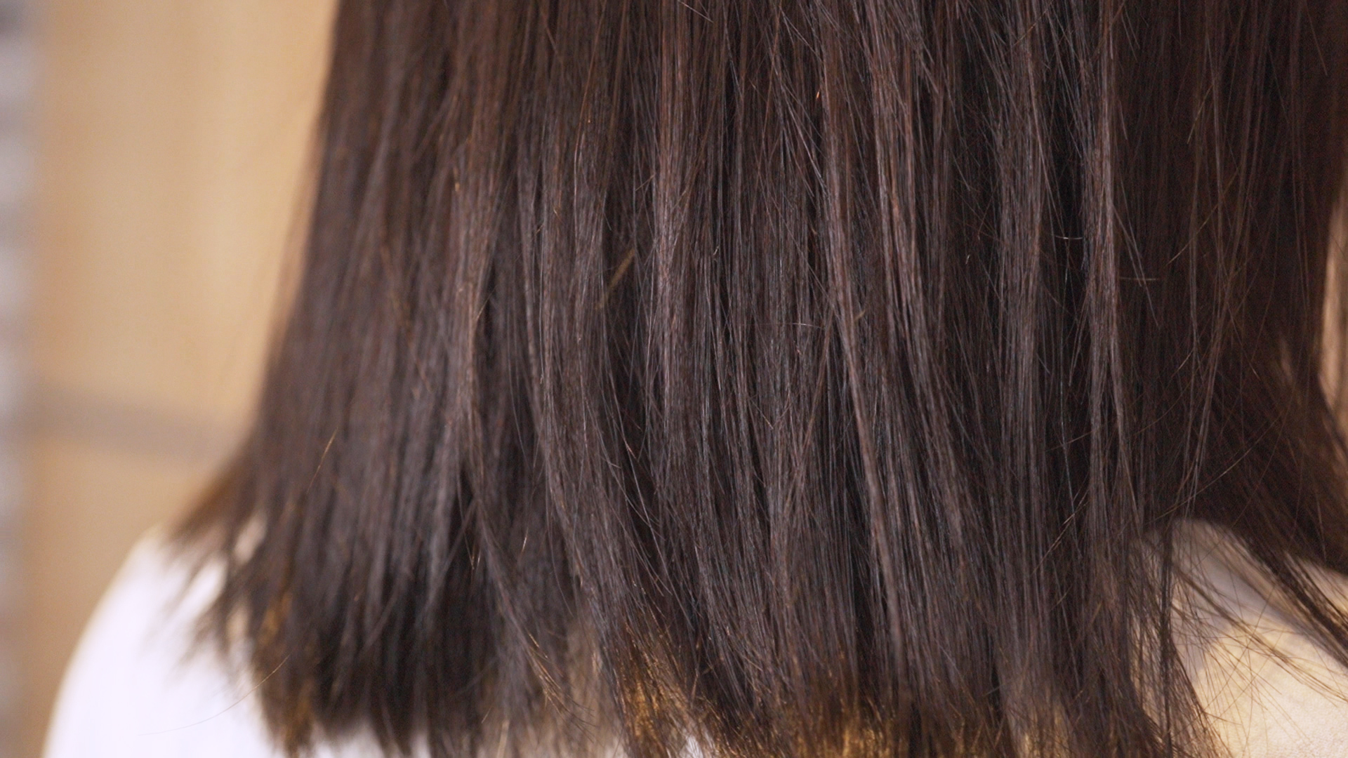 Here's a close up of Rachel's hair texture before the hair treatment and Korean Perm. Limp, frizzy with visible split ends.