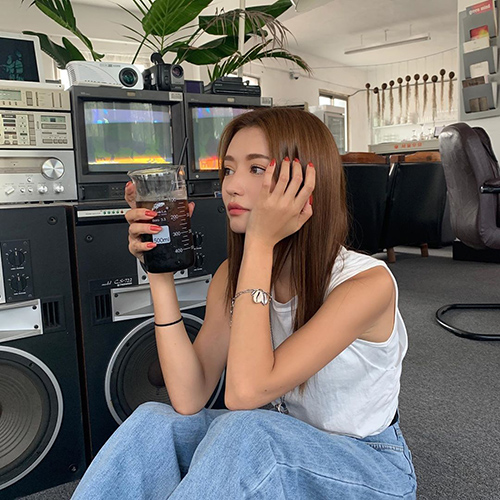 Park Sora, model for Stylenanda, Korean fashion brand based in South Korea, with brown straight hair