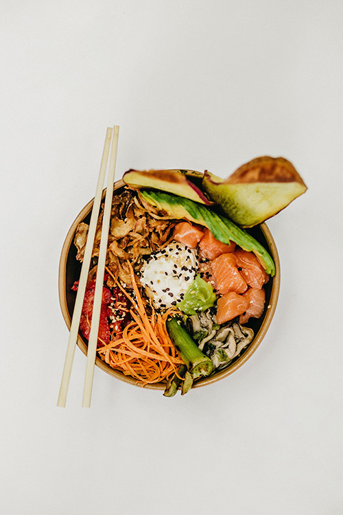 Poke bowl, filled with onsen egg, avocado and salmon sashimi. Foods like salmon, avocado and eggs contain omega 3 fatty acid, which helps to keep your scalp healthy and moisturised.