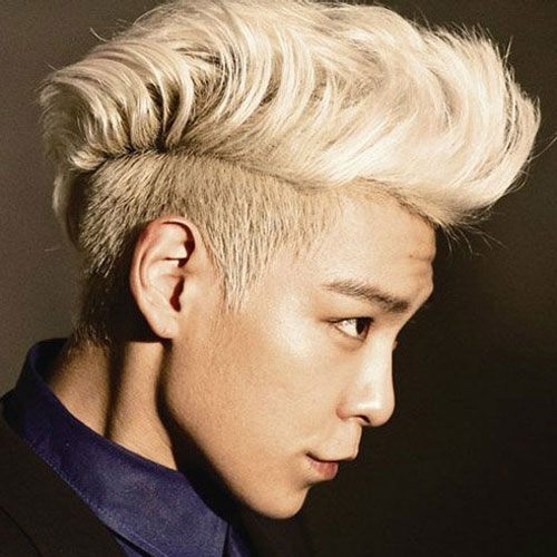 TOP, member of BigBang with a two block hair cut, styled into a pompadour