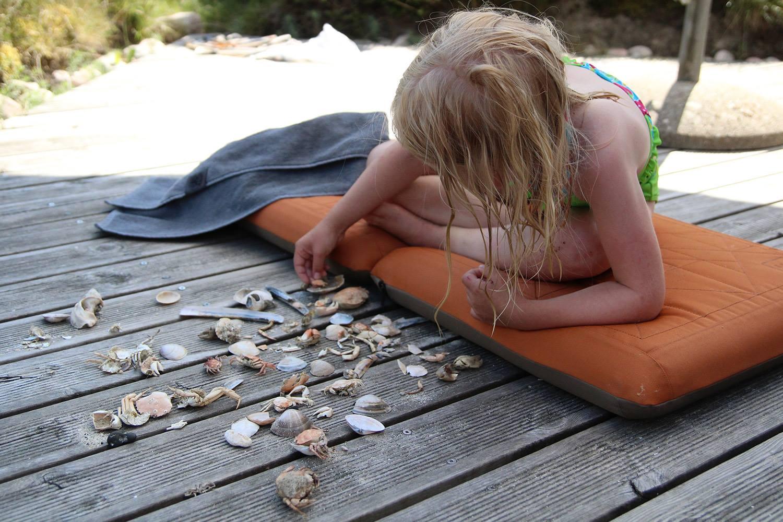 A collector enjoying the beach findings
