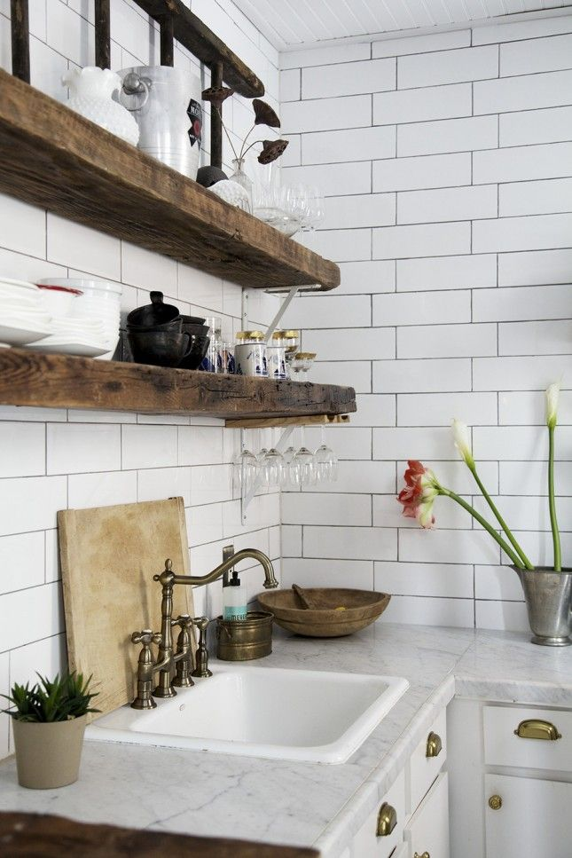In a rustic style kitchen, brass faucets and handles add a contemporary touch. I love the combination of brass, wood and marble - classic but not showy.