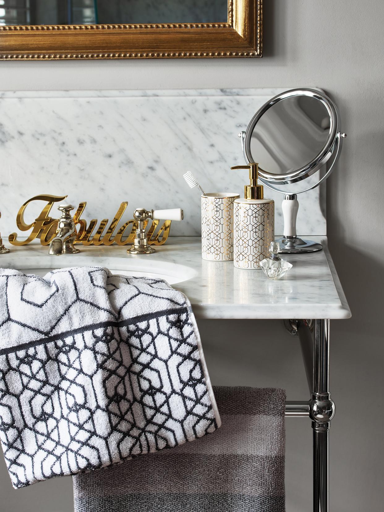 'Fabulous' bath sign - £6, Gold Geo tumbler - £3, Gold Geo dispenser - £5, White and Chrome stand mirror - £8, Grey Geo bath towel - £6, Savoy Stripe bath towel - £6.