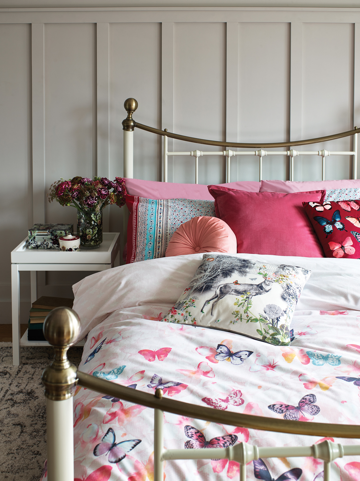 White tray side table - £29, Floral print glass jewellery box - £12, Floral trinket pot - £6, Nancy double bed in cream - £199, Lace butterfly double duvet set - £12, Patchwork double duvet set - £12, Pink round pinwheel cushion - £5, Velvet cushion - £8, Butterfly printed cushion - £5, Deer cushion - £5, Homemaker ivory and grey traditional rug - £40.