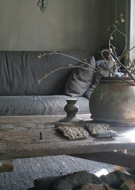 Materials in the wabi-sabi home are organic and tactile. Try a jute rug and crumpled linen bedding. Wooden furniture and tarnished metal add to the look.  Image via Pinterest.