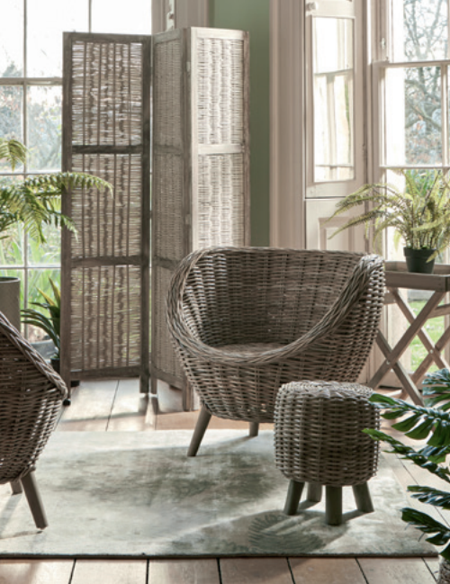 Rattan and wood screen, £150.  Rattan tub chair, £275.  Round rattan low stool, £75.
