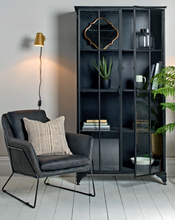 Black vintage leather armchair, £1200.  Black iron display cabinet (tall), £1175.