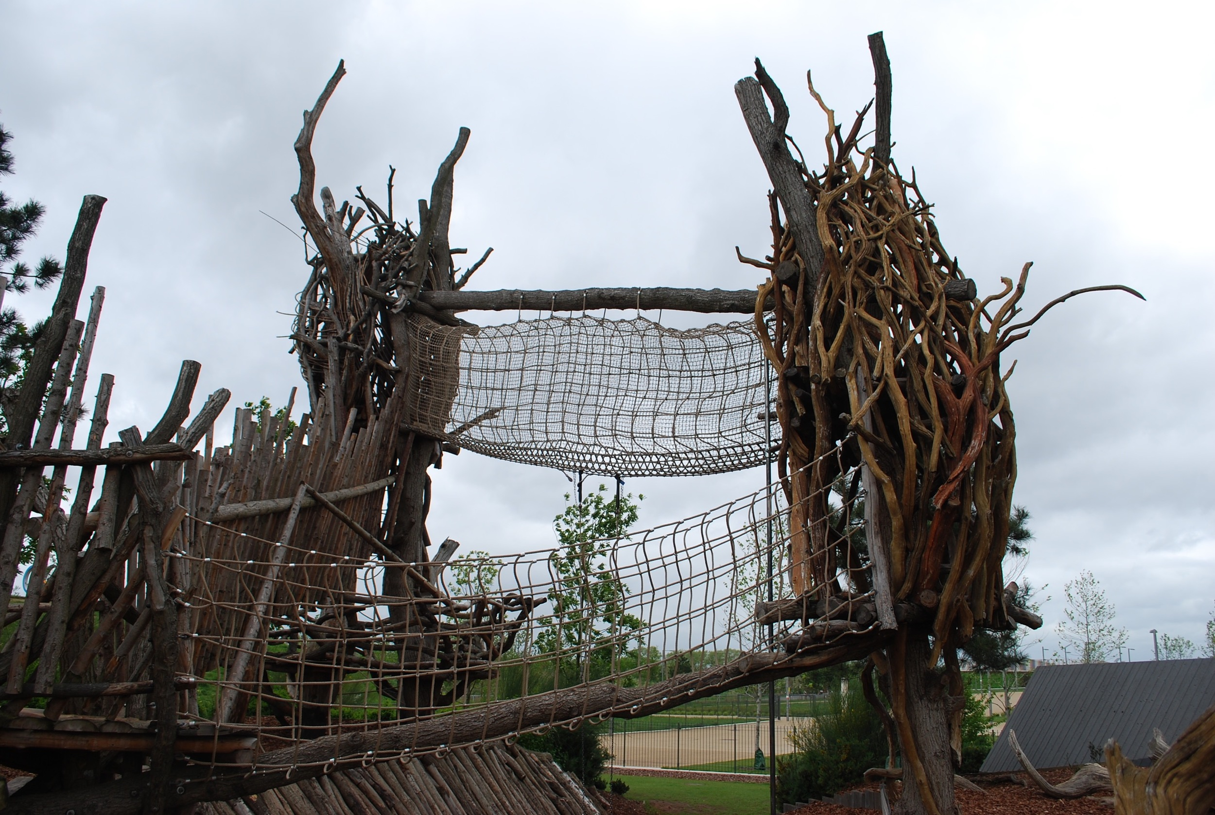 Log towers and net walks give the illusion of danger at Tumbling Bay Playground