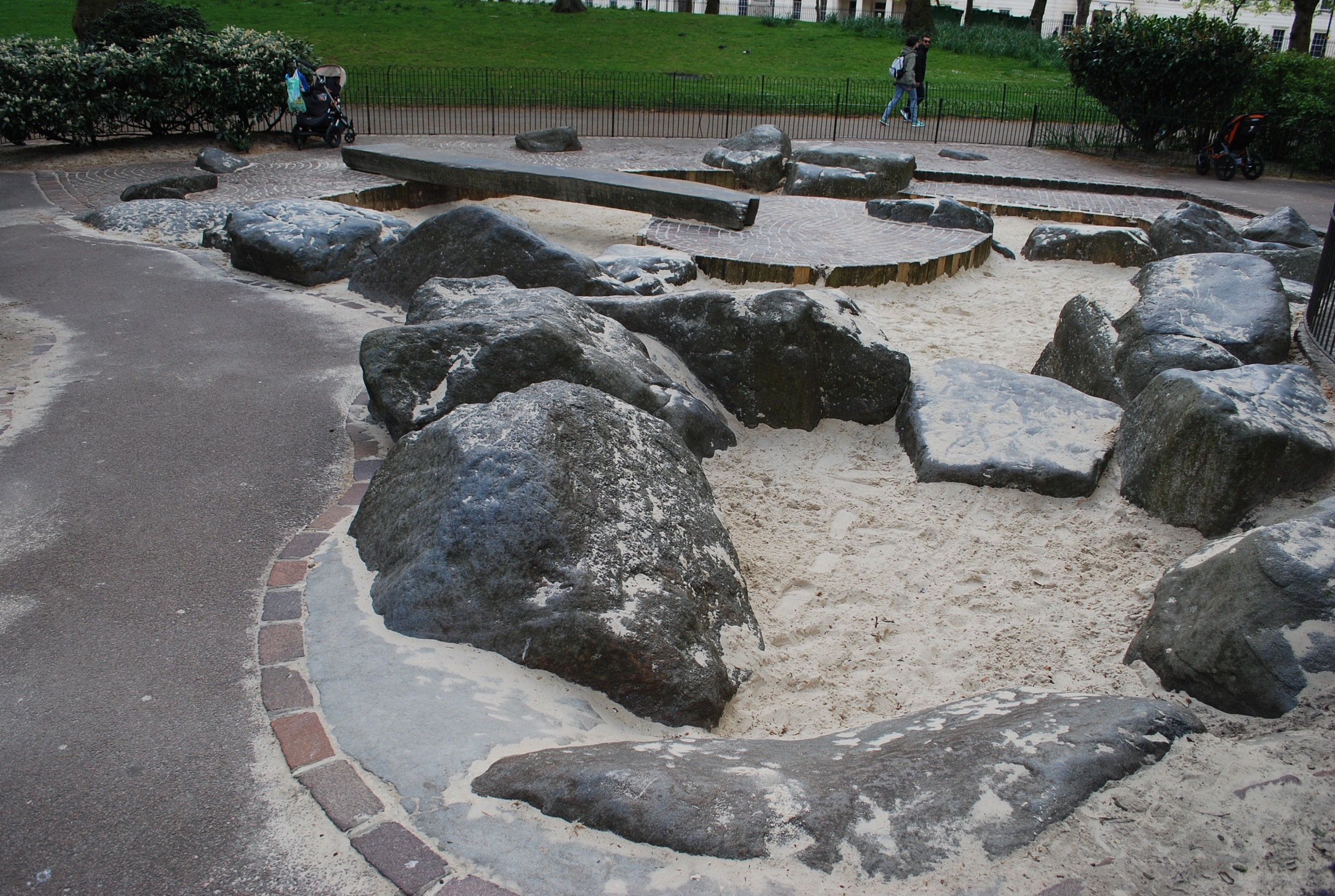 Boulders and sand, plus a stone slab bridge define the primary play space of Wellington Barracks Playground