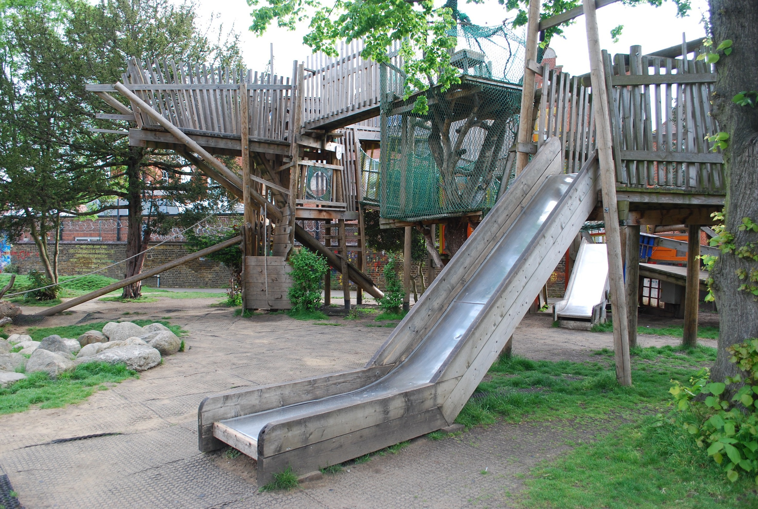 Custom built slides and forts at Kilburn Grange Park