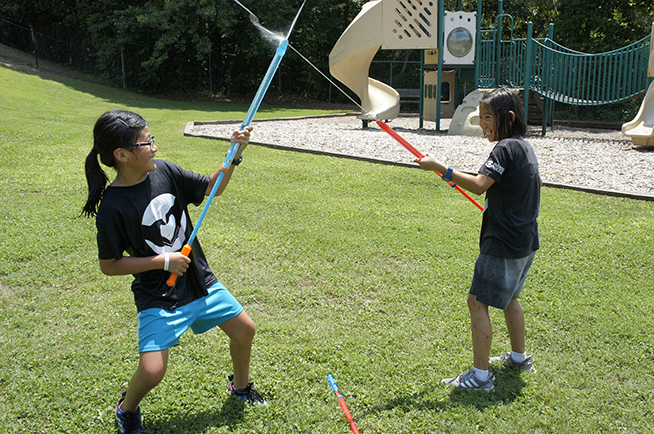 Campers at play with watersabers
