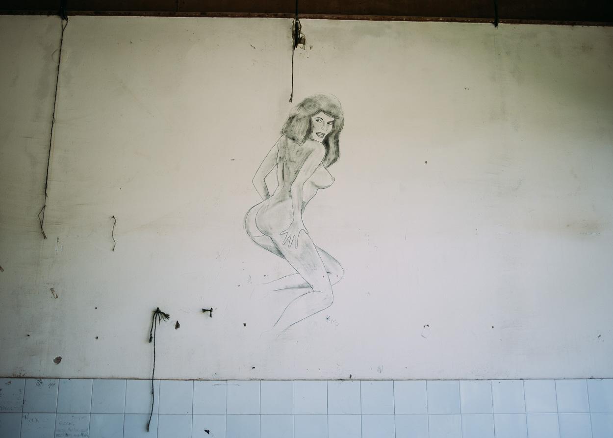 Graffiti adorns the walls of an abandoned former UN building in Srebenica.