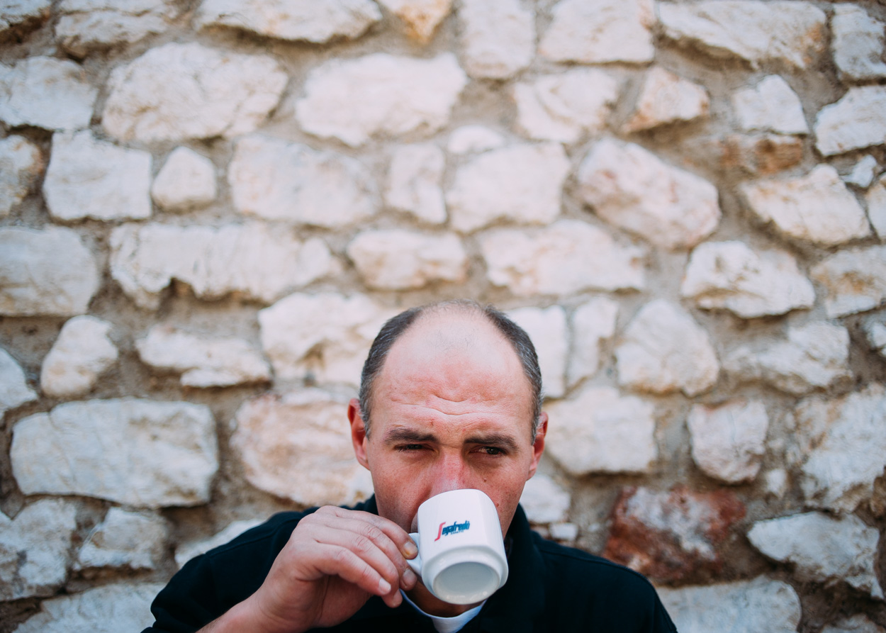 Andrej, a former Special Police Officer, drinks coffee in Old Town Sarajevo.