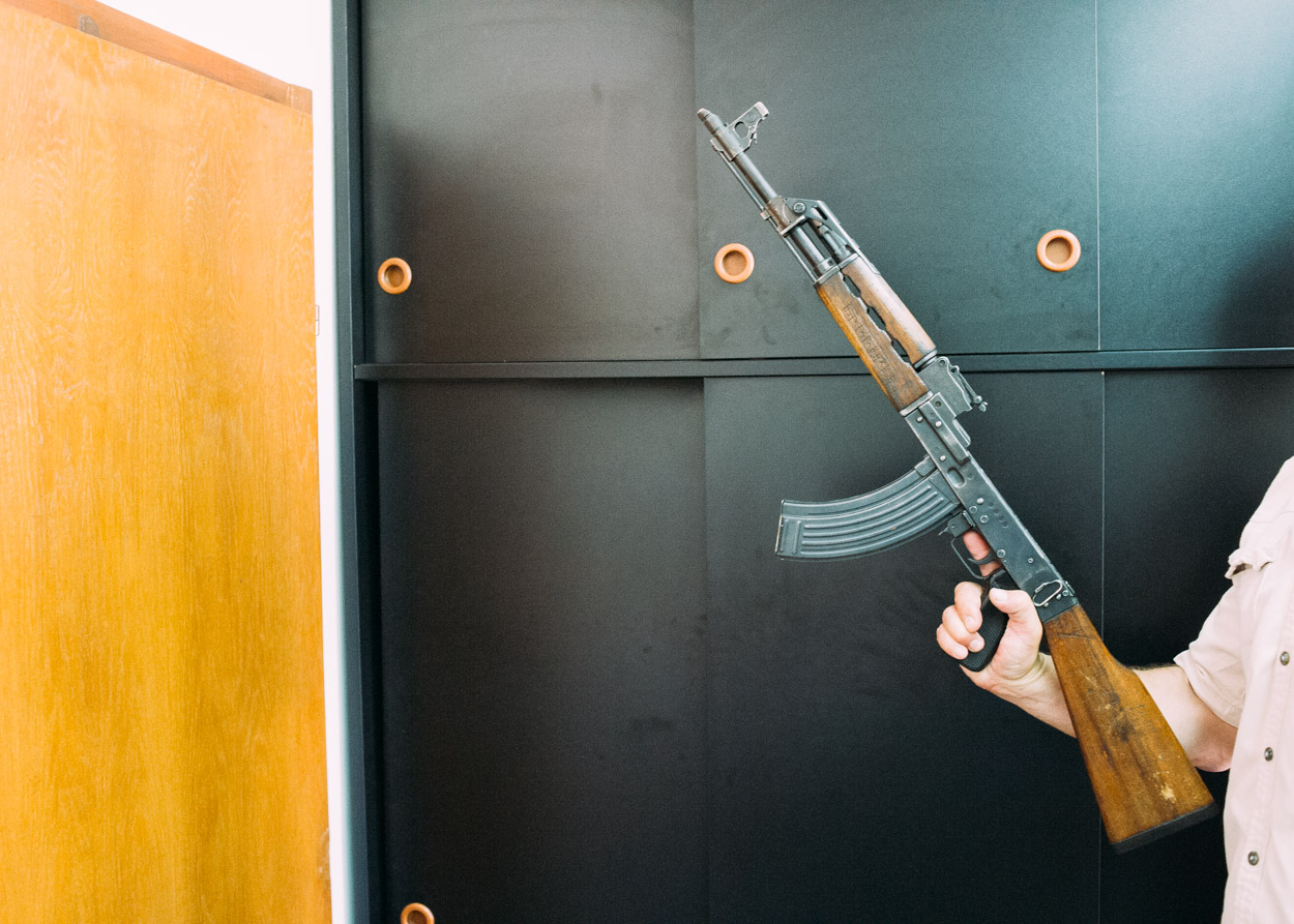 A deactivated Kalashnikov AK-47, one of the few weapons we were able to locate in our search. The same person who presented this gun also had a .50 cal machine gun and a rocket launcher which were photographed, however as we went to leave he asked to see and then deleted those photographs.