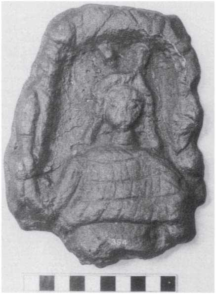 Lead Plaque of Horned God (or Goddess?) found in Chesters, Northumberland. Miranda Green.