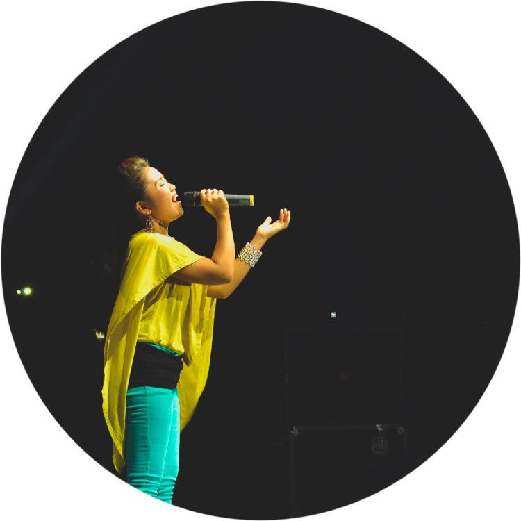Woman Singing on Stage_Circle.png