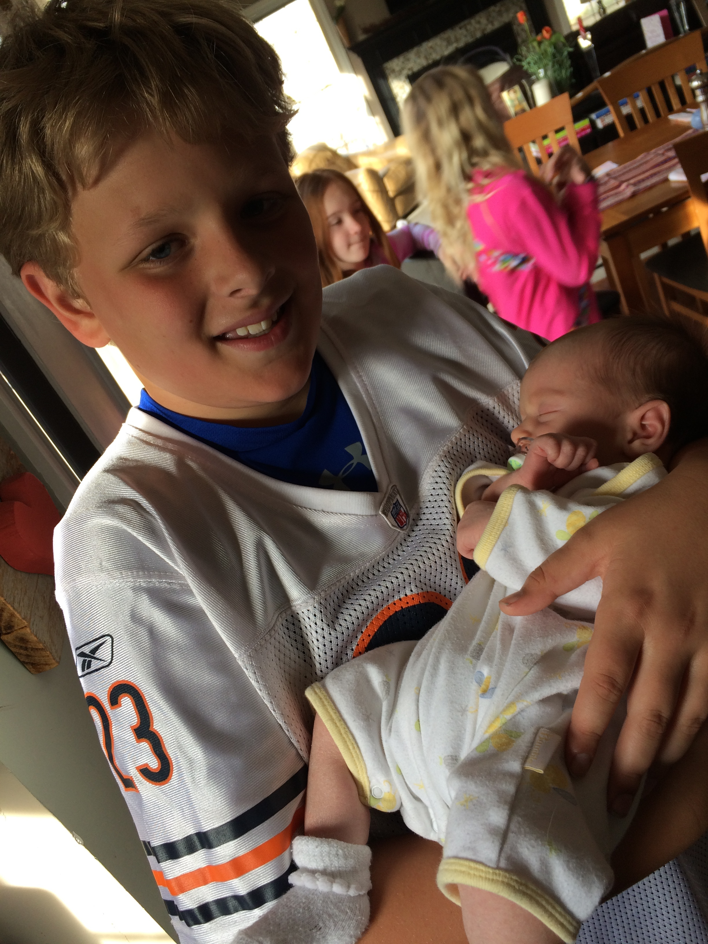 Football jerseys and babies: Sam's model for the modern man.