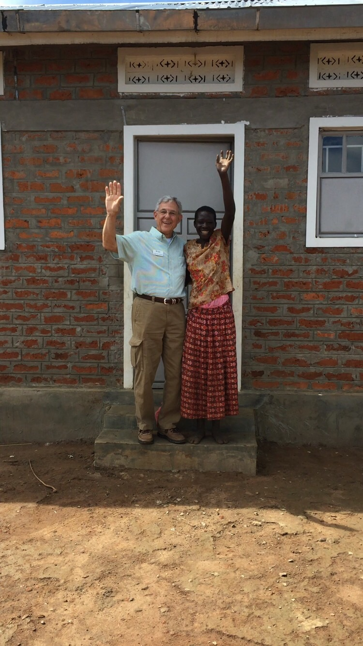 Grace, and our friend David in front of her new home.