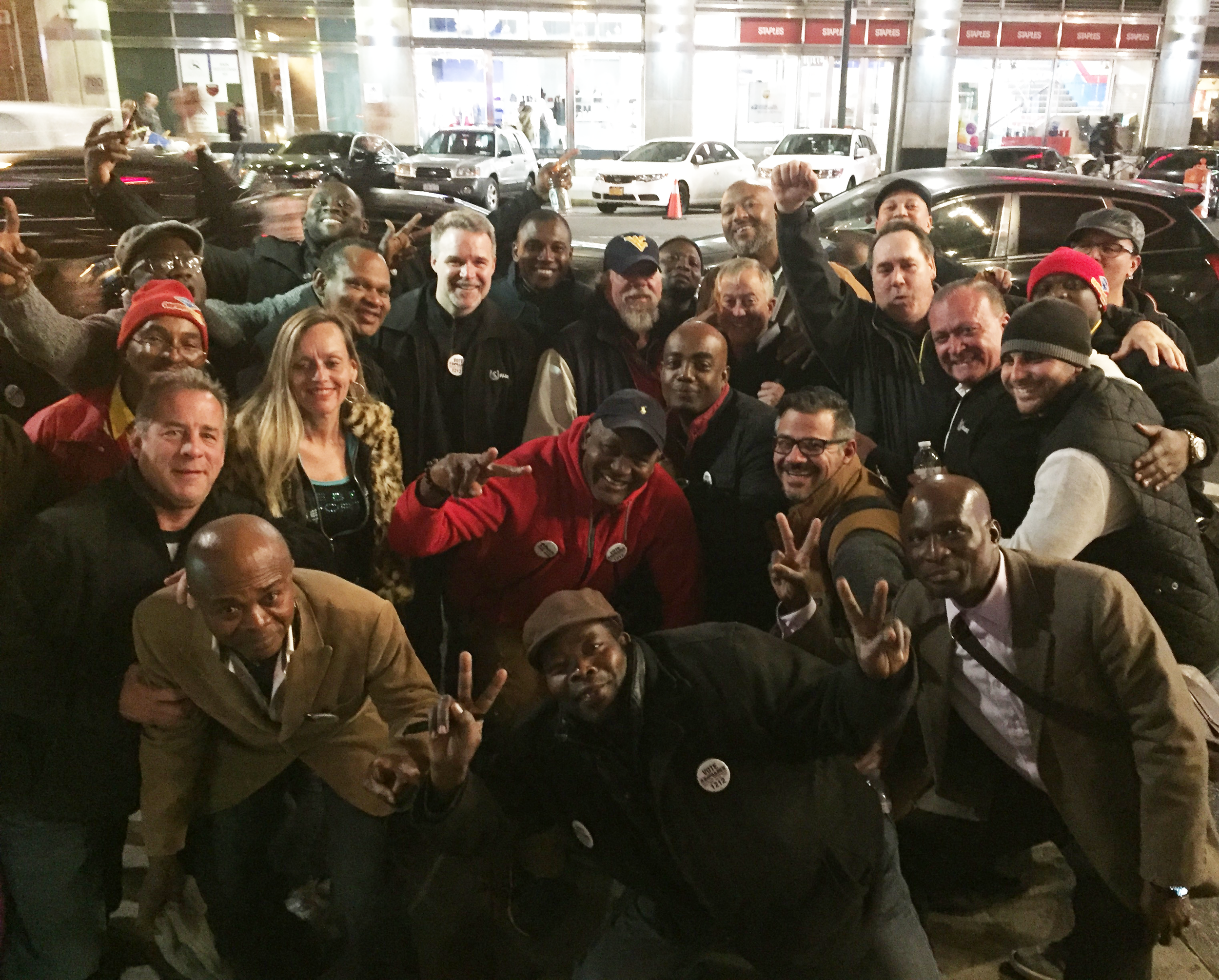 USWU organizers and JAD members celebrate after Local 1212's victory in their election to represent ticket agents and tour guides at City Sights/Gray Lines.