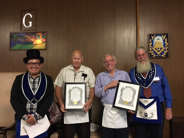 Wor. John Lawler (middle left) and Wor. Lee Cleveland (middle right) receiving their certificates from WM Edward Dalusong (left) and Bro. Mike Lampe (right)