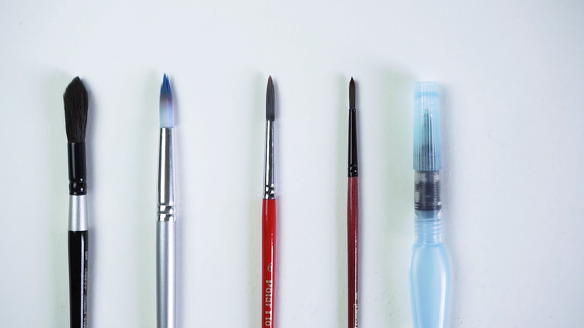 Go-to brushes. A jumbo round, 8 round, 6 round, 4 round and a Pentel Aquash water brush that's perfect for travel