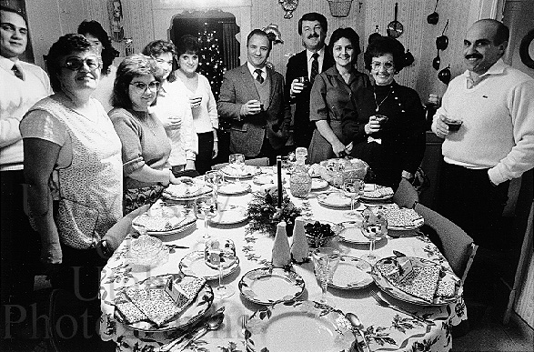 "Typical Italian-American family all set to enjoy Christmas dinner with the ""good plates"" set at the table."