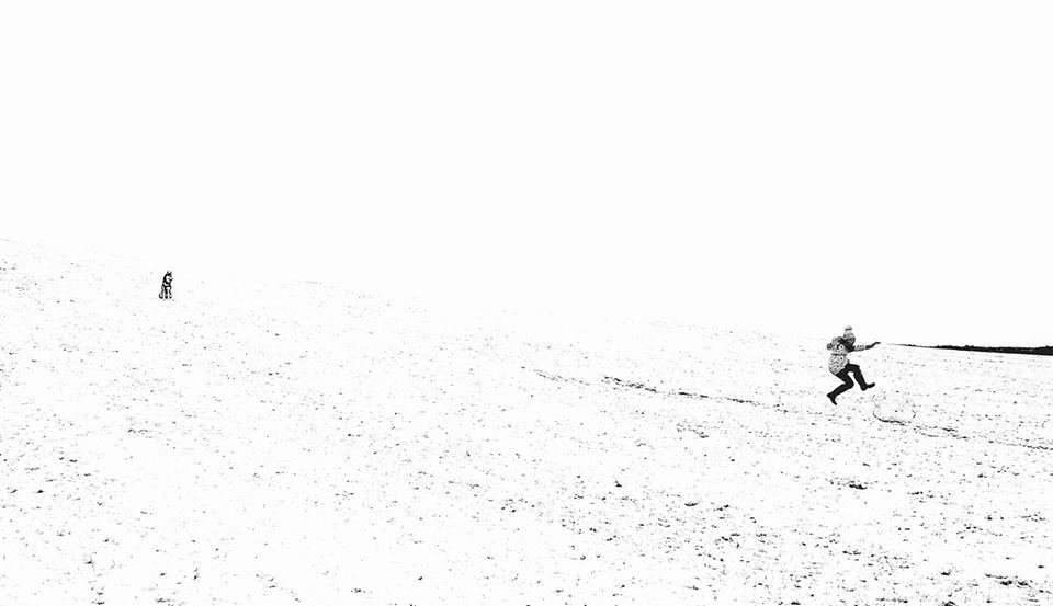 emma crushing snow boulder.jpg