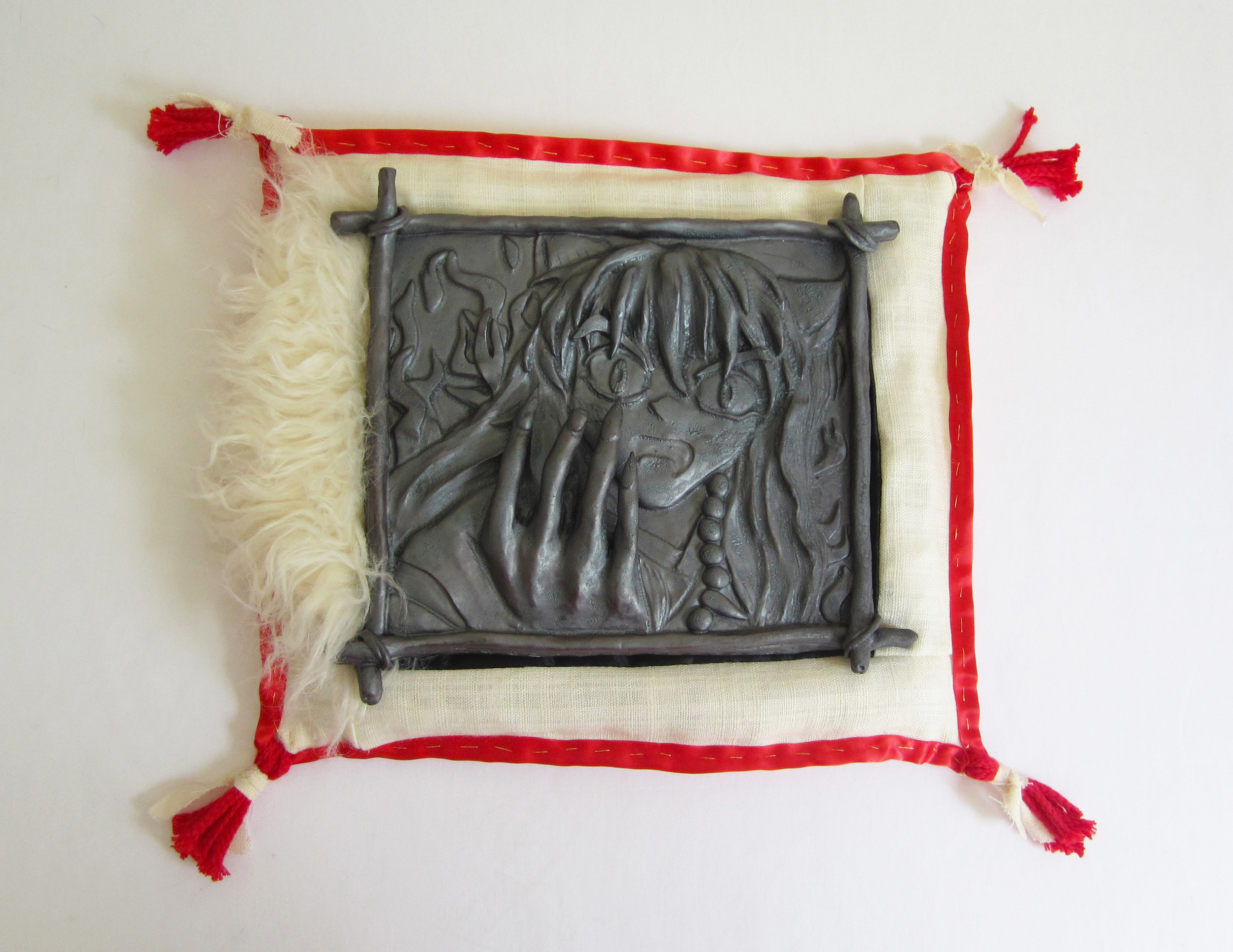 Inuyasha, 2017  glazed porcelain, linen, satin, satin ribbon, cotton cord, faux fur, cotton scrap stuffing  13 x 15 x 2 1/2 inches