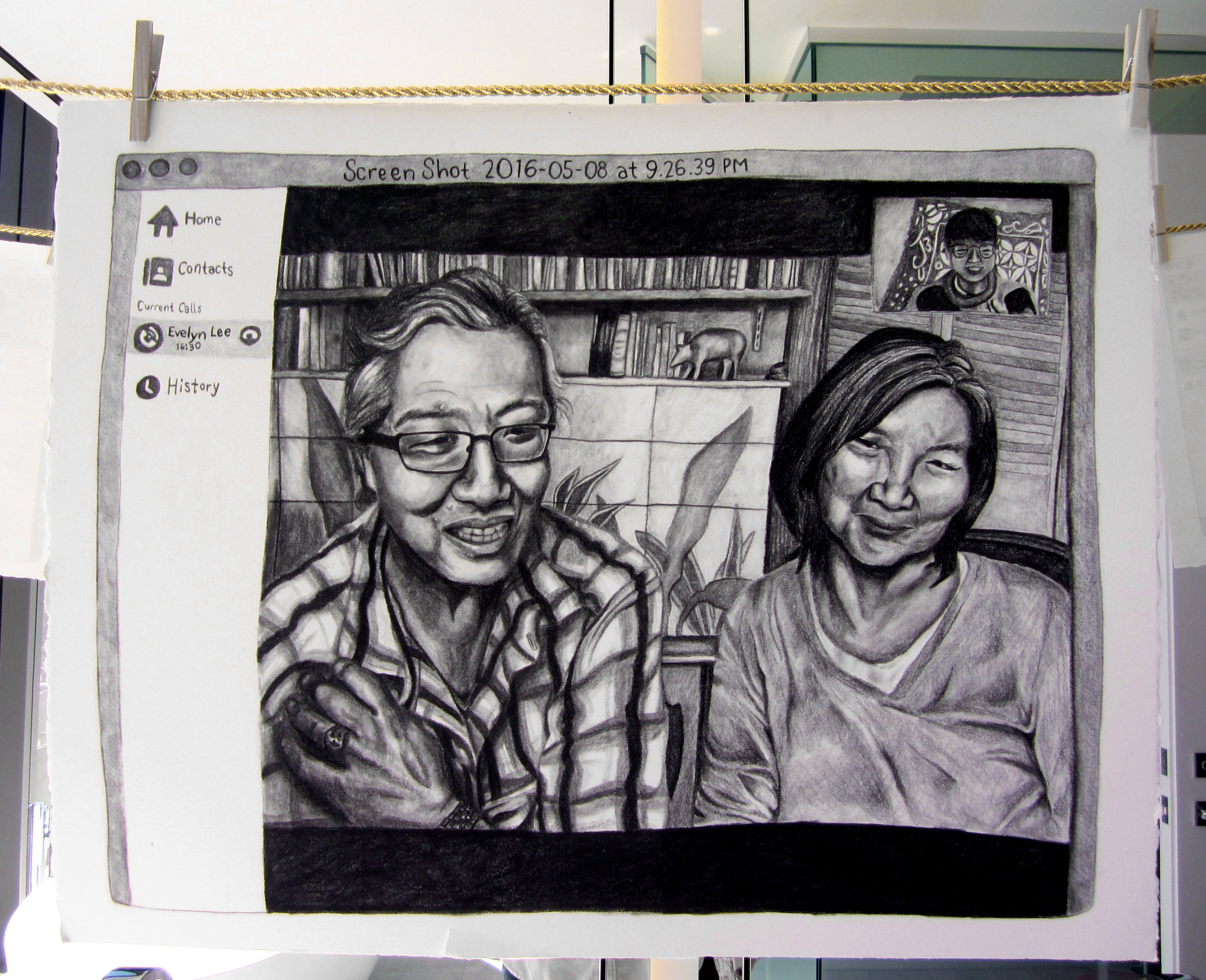Screenshot 2016-05-08 at 9.26.39 PM (Mom and Dad), 2017  charcoal on paper, wooden clothes pins and cord  20 x 24 1/2 inches