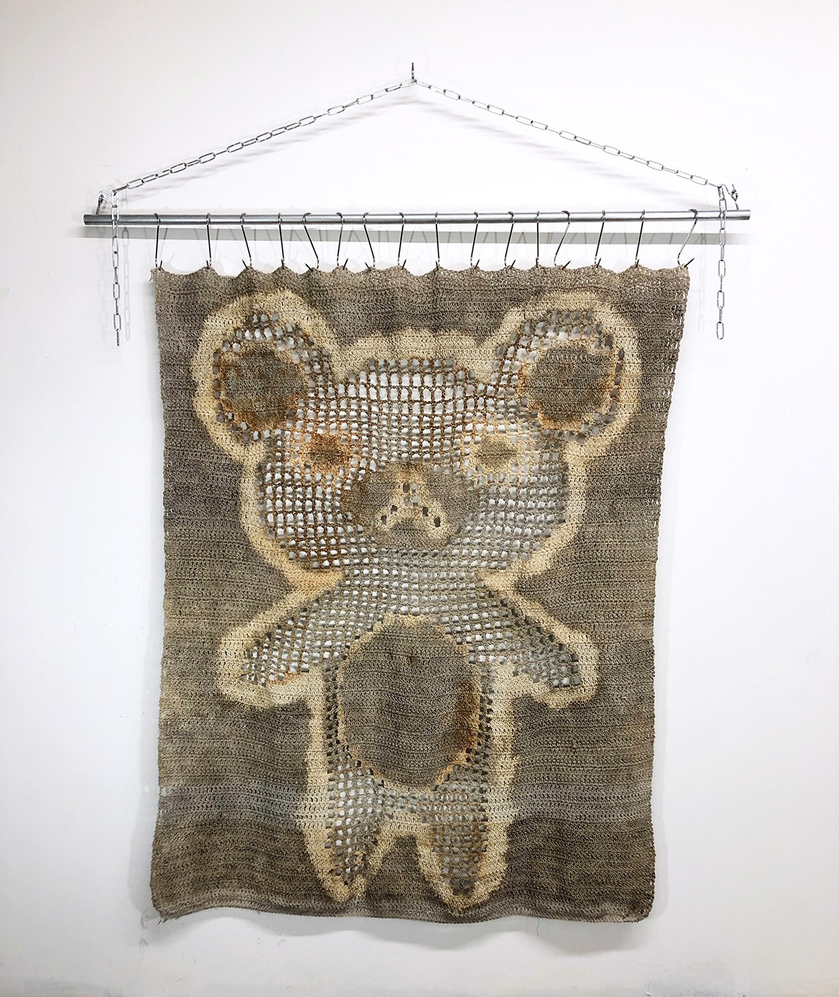 ghost , 2019  Cotton twine dyed with bleach, soil, and rust; metal pole, meat hooks, chain, hardware  56 x 80 x 2 inches