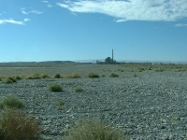Backfilled and remediated waste site, B reactor in the background