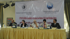 The image in this article is of a panel of 5 people at the event.
