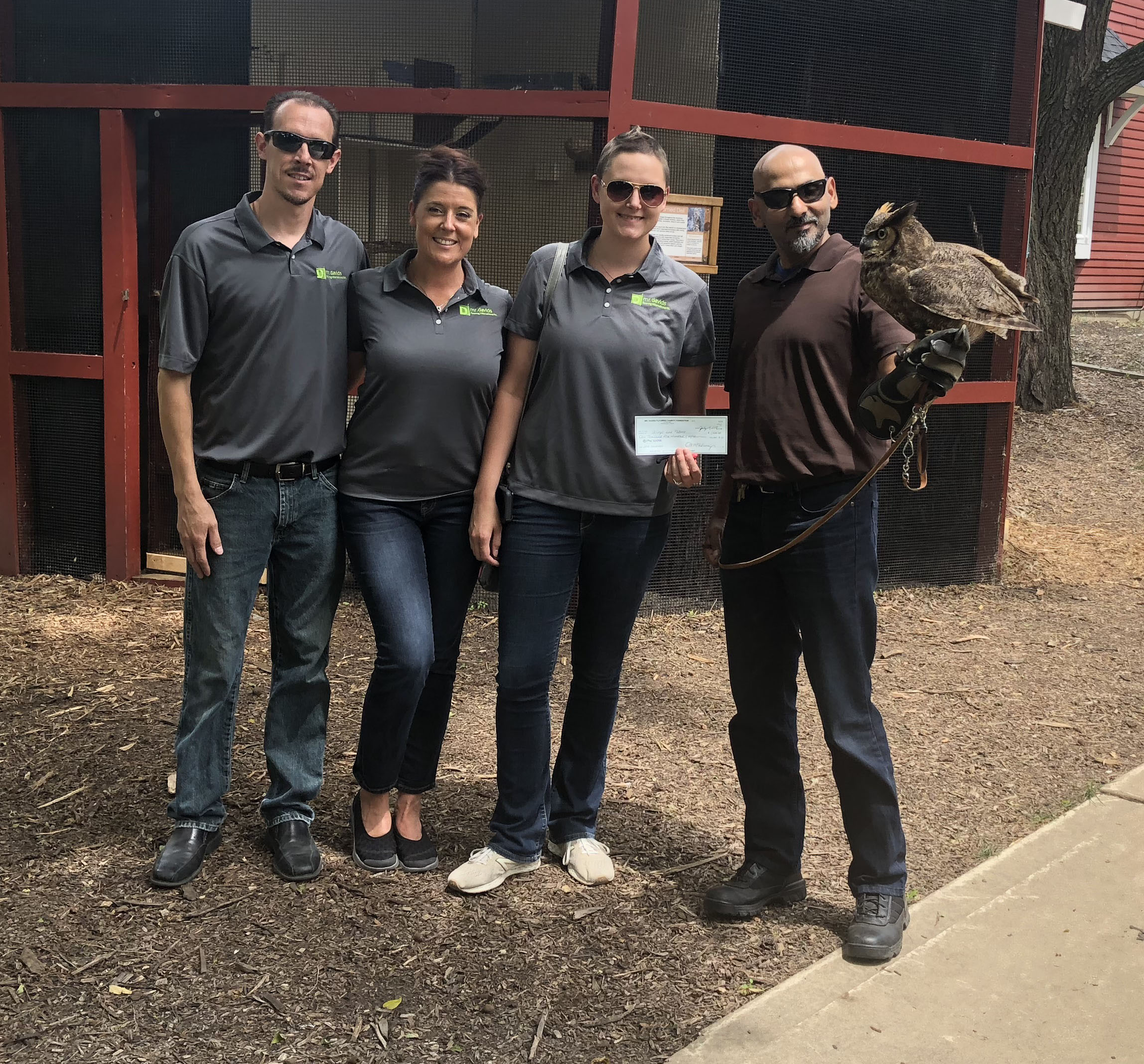 Brian Schmidt, Sherri McKinney, Kristina Russell and Nabeel Rasheed at the Wings & Talons conservatory at Springbrook Nature Center in Itasca, IL.