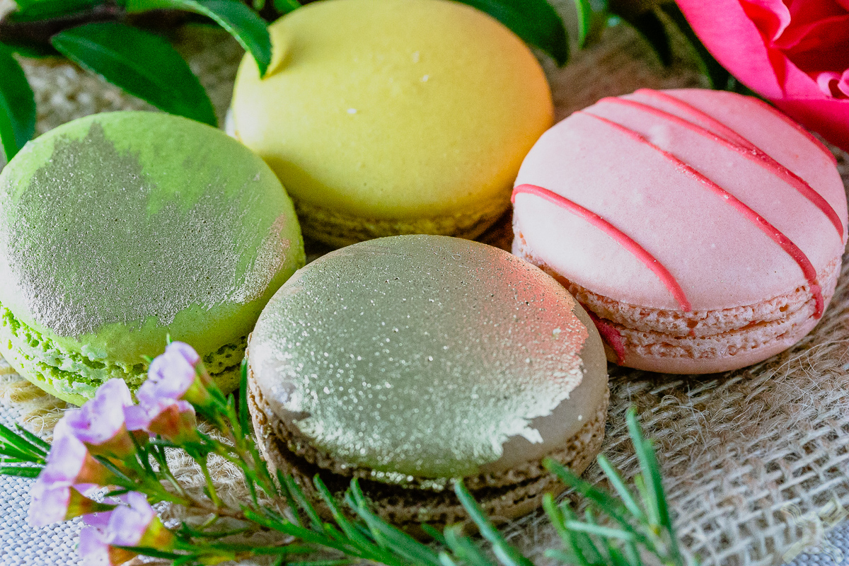 Salted caramel, vanilla, orange strawberry, and apple macarons, each tasty in their own way.