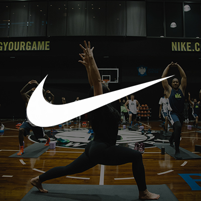 Claire's work with Nike Proving Grounds guiding large yoga session groups.
