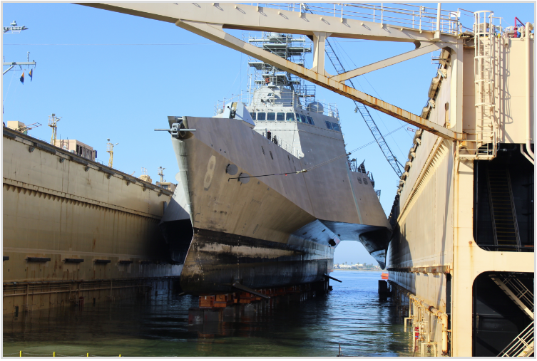 USS Montgomery (LCS-8) enters dry dock for Post Shakedown Availability (PSA) at BAE Systems Ship Repair facility. US Navy Photo